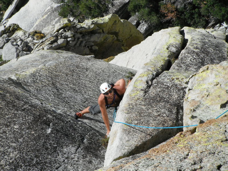 Rob Beno nearing the top of the crux corner on P2.