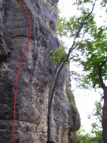 Starting from the southeast of the Quadrangle next to Up n Off. Climb up through thin face without holds from Up and Off and the obvious knob on the corner of the route. Use delicate holds up the overhang and look for the small bowl shaped under cling (crux). Strechy moves thru next section towards loose looking flake, then work your way to the top.