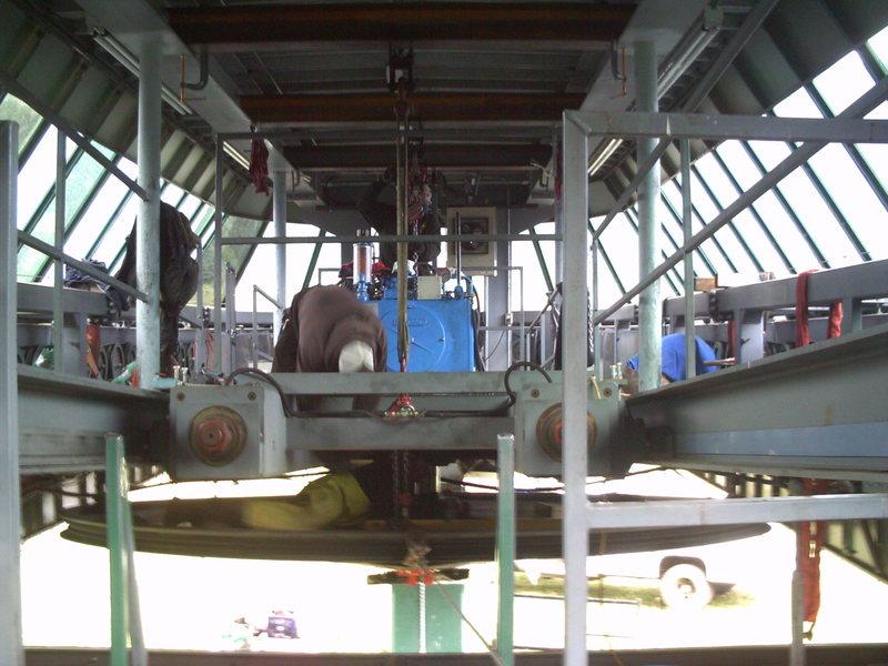 Raising the repaired bullwheel.