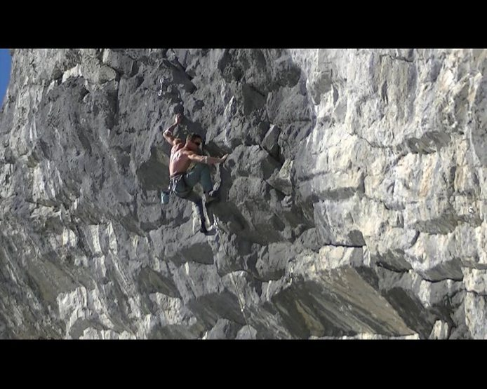 The crux move in the upper half of the route