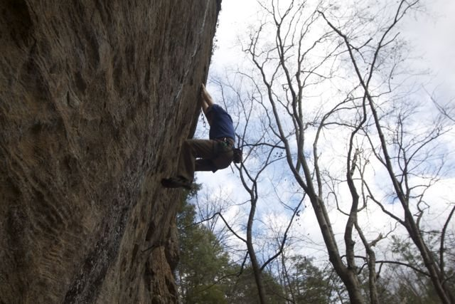 On one of the good holds between hard moves. Not your typical Red 5.12. A series of escalating crux moves between rest holds.