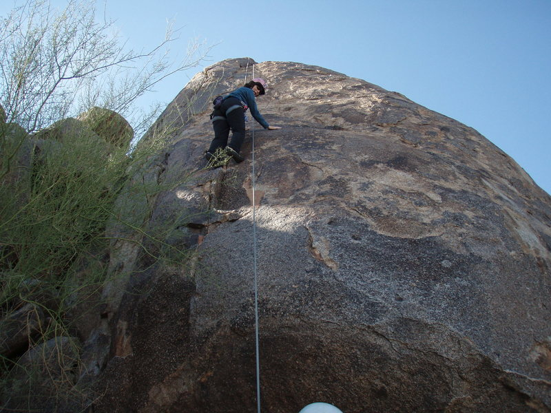 Suzanne face climbing on 'Brown Sugar'