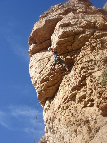 Jes M. about to finish the jugs section and move into position for the crux.