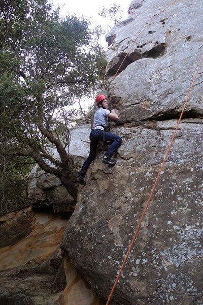 Drew climbs Puny Prow at San Ysidro in Santa Barbara.