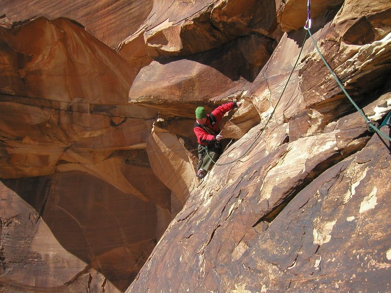 Rob Gauss starting the notorious traverse pitch of Jubilant Song, Windy Peak, Red Rock Canyon NCA, Nevada.