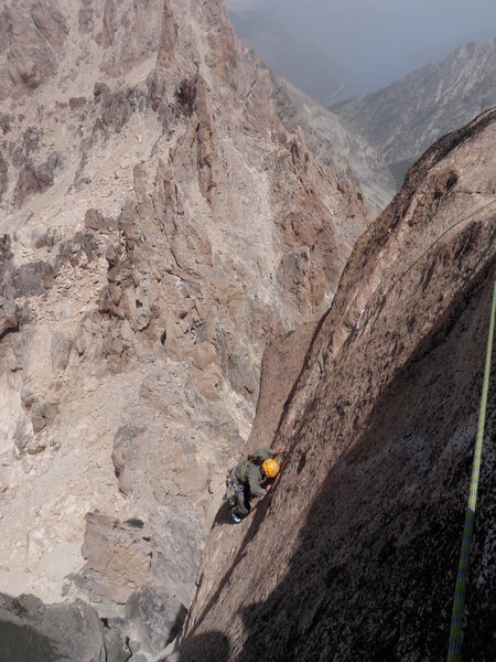 Delicate, bolt-protected face climbing on the summit pitch- the technical crux of the route.
