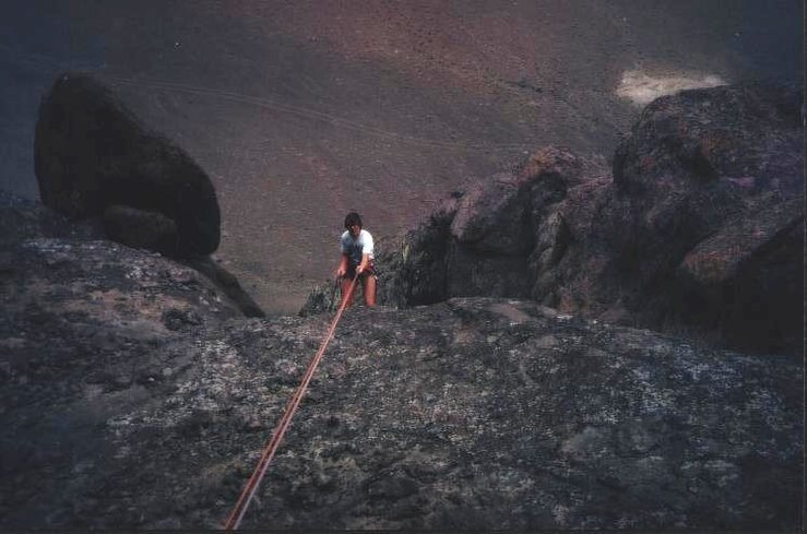 Scott Dalen on an early reconnaissance climb, rapping down the '3rd class' gully without his helmet, a decision he is about to regret.