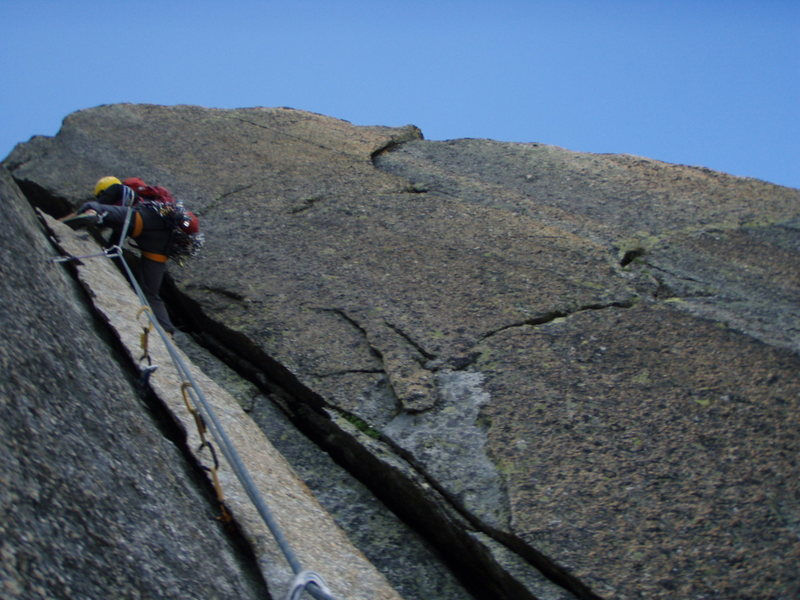 The alternative to the crux 7a pitch of Conquest, ascending a splitter flake followed by a short chimney.