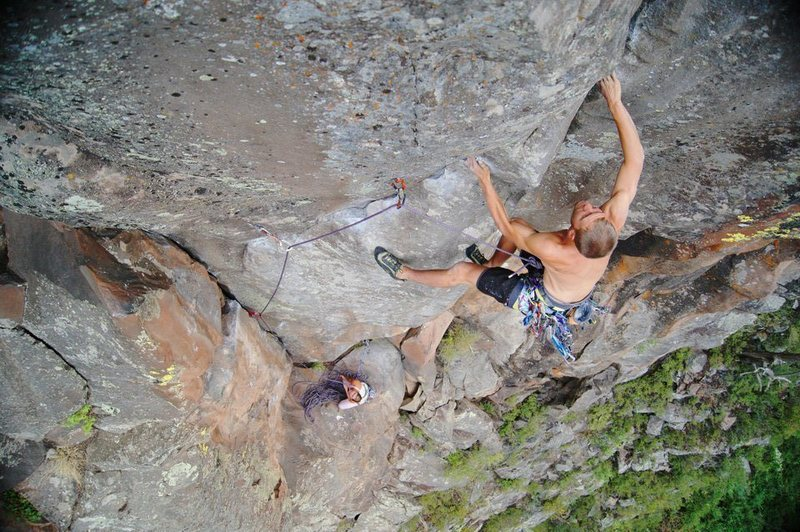 Joel Unema at the crux transition of Phantsam 5.11, during his onsight.
