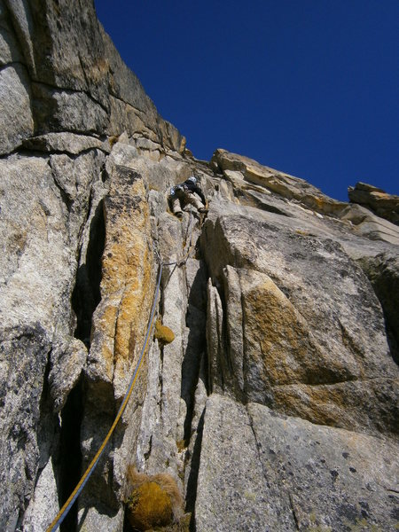 Climbing the extensive corner / chimney system in the lower half of the Perrenoud route