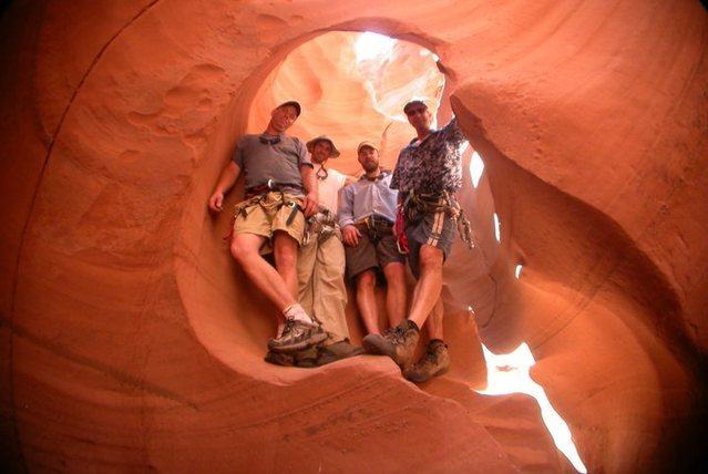 L-R  Kevin, Myself, Joel, and Dan holding up the Waterhole, in Waterholes Canyon, AZ on what I thought was my tenth trip down?