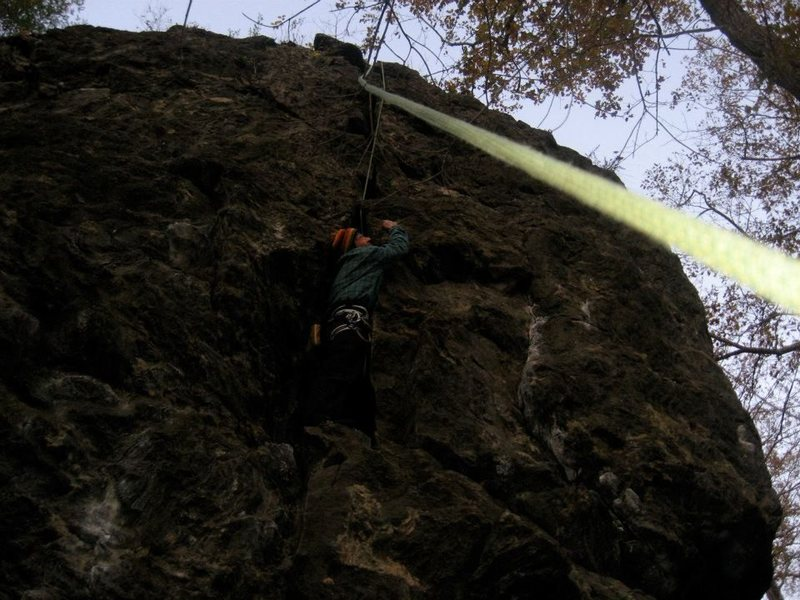 Rock Climbing Photo: crackheadNH on a lower standing platform on the 5....