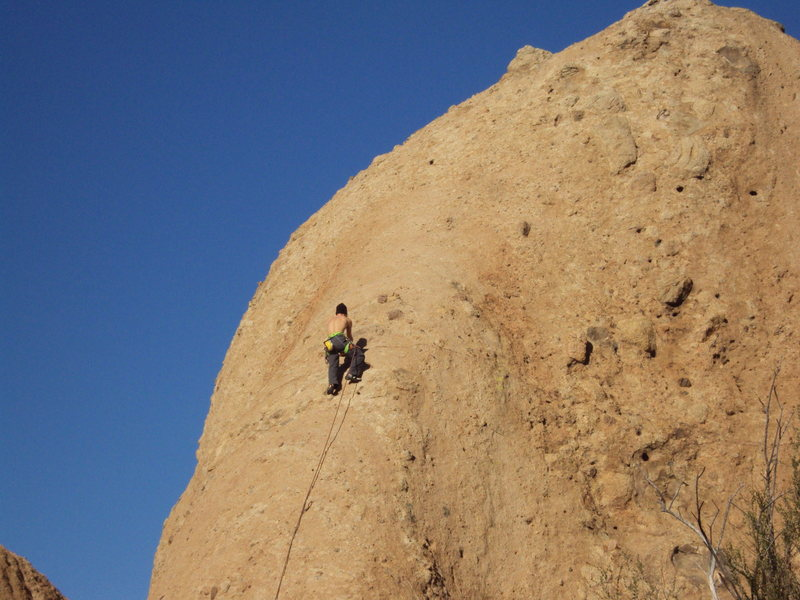 "A climber moves up the top portion of ""Rainy Day Woman,"" on a wonderful, warm winter day, at Texas Canyon."