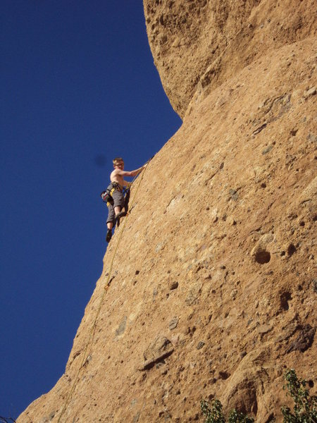 """A climber nearing the top of """"Texas Chainsaw Massacre,"""" on a glorious winter day in S. California."""