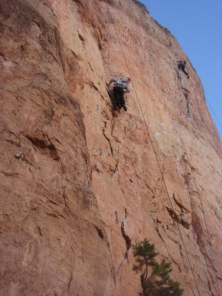 A descriptive shot of the whole route@SEMICOLON@ Jennifer climbing Beach Ball.