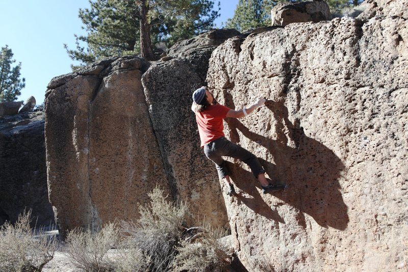 Finishing the crux sequence with the move to the lip.