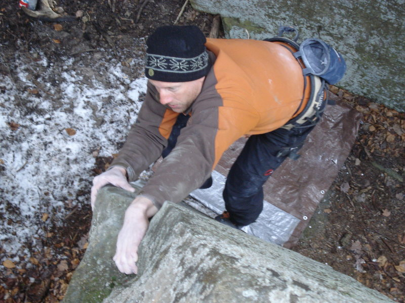 """Paul on """"the knife edge"""" boulder problem.  It can be found in the Cave Area."""