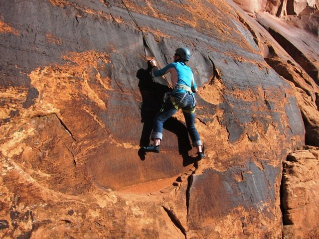 "LeAnn on the bottom portion of the route known as ""Black and Tan Slab"" in SG's Best Climbs Moab guidebook.  Fun!"