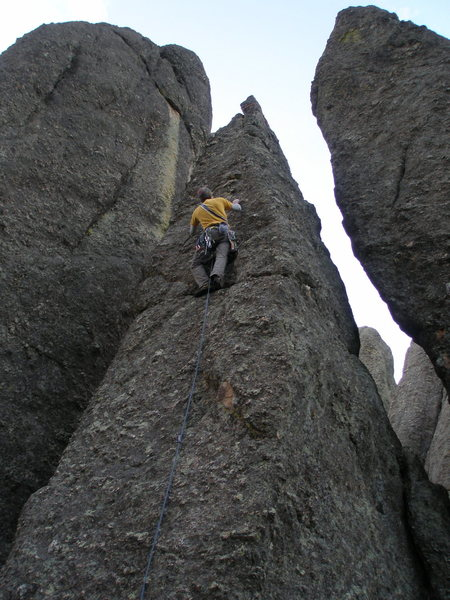 Shortly after clipping the piton, with a ways to go before the top.