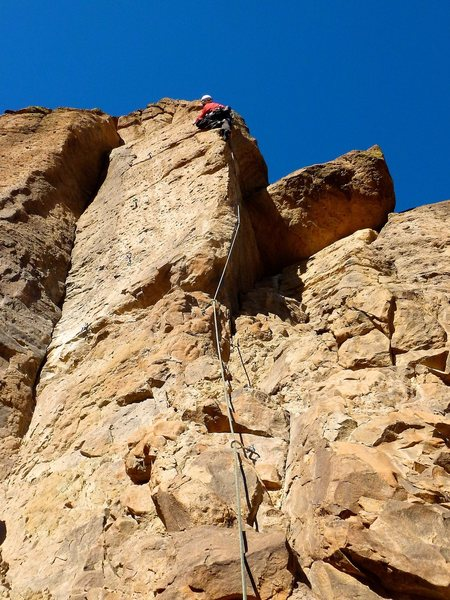 Moving out from the face to the arête for the route's crux moves. January 2012.