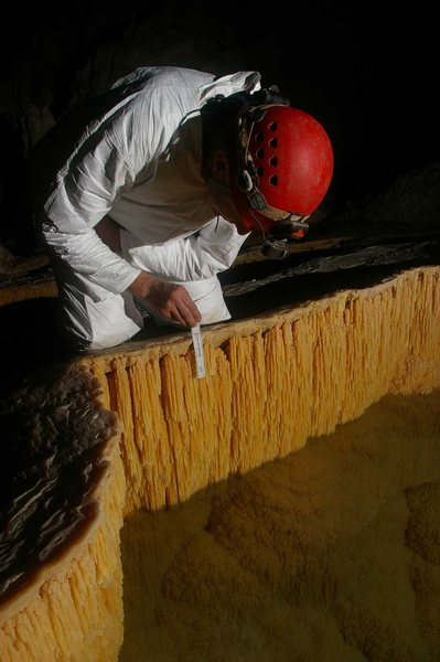 Examining microbial influenced pool finger cave formations in Lechuguilla Cave.