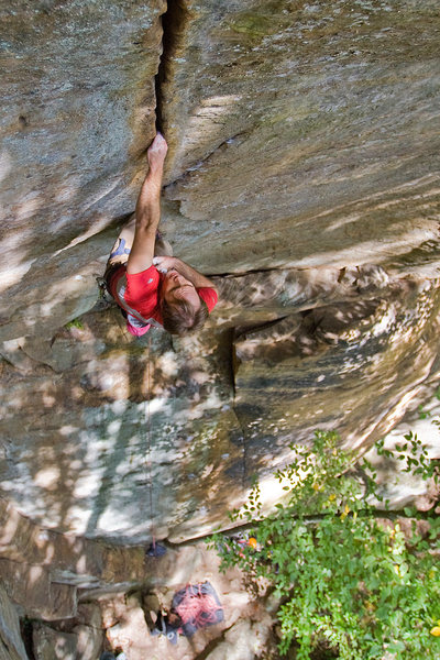 "Placing the last piece of gear, a .4 camalot, from a hold that we called the ""bloody ringlock.""  It's actually the last decent shake out spot before the wall kicks to nearly 45 degrees on rattly fingers.  Fall, 09, photo by Tristan Croll."