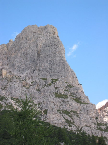 Torre Piccola and Torre Grande (blended in behind) from the parking lot. Several climbers on the Comici route.<br> <br> Picture is zoomed.