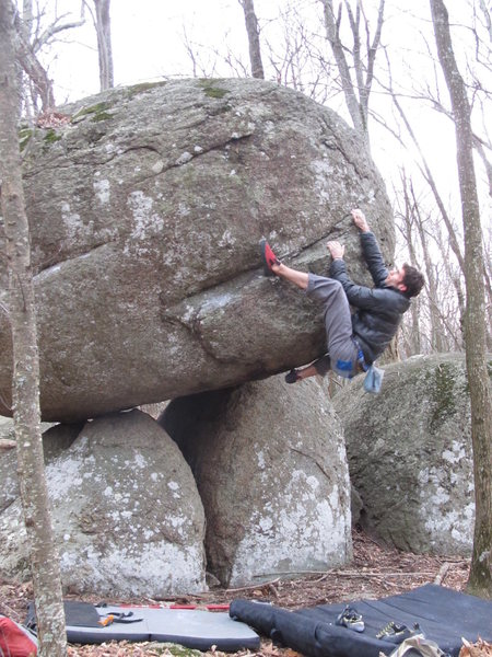 """Aaron James Parlier working on the FA of """"Precipice"""" (V4)."""