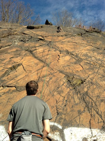 Frank belays while Kristin nears the crux of Safe Harbor Direct on a borrowed toprope - thanks climbing neighbors.