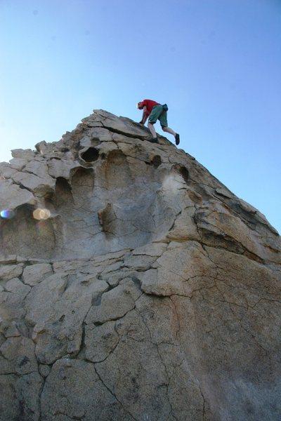 Chris high up on the Hueco Boulder