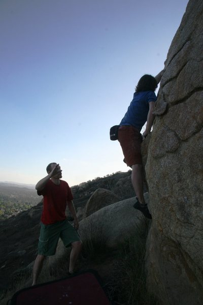 Rock Climbing Photo: Moving up onto the boss hold on Street Mantle, V2