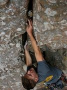 Rock Climbing Photo: Matthew Miller placing bomber cam on Involuntary M...