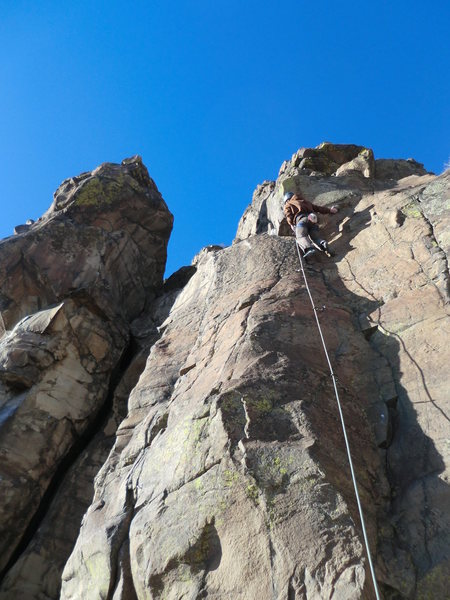 Josh Darnell entering the crux, Cool Thing at N. Table, on a cold Jan. day.
