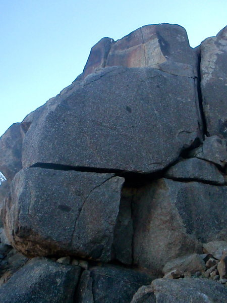 Fear Wall? Great crack traverse with a couple stiff moves up and onto a ledge. Continue up crack and dont hesitate.