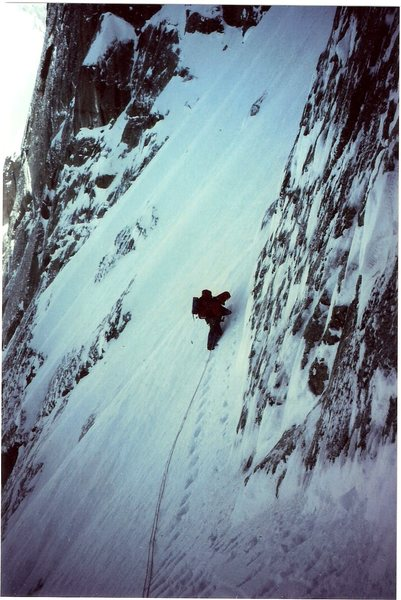 Jeff Burton on upper part of snowfield leading into base of the N.Q. Couloir, April 1992.