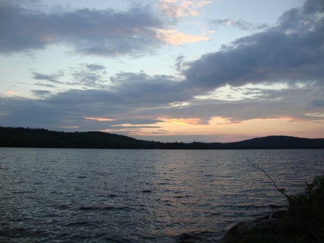 Sunset over a lake in Maine along the Appalachian Trail.