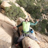 """""""A Caballo"""" Belay atop pitch one."""