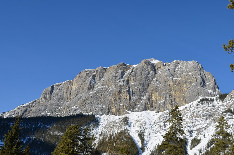 The East End of Rundle (EEOR) on Mt. Rundle above located above Canmore, AB as seen from the Junkyards ice area below the Grassi Lakes Dam.