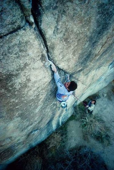Kurt Smith on the Moonbeam Crack (5.13a), Joshua Tree NP. <br> <br> Photo - K. Smith Collection.