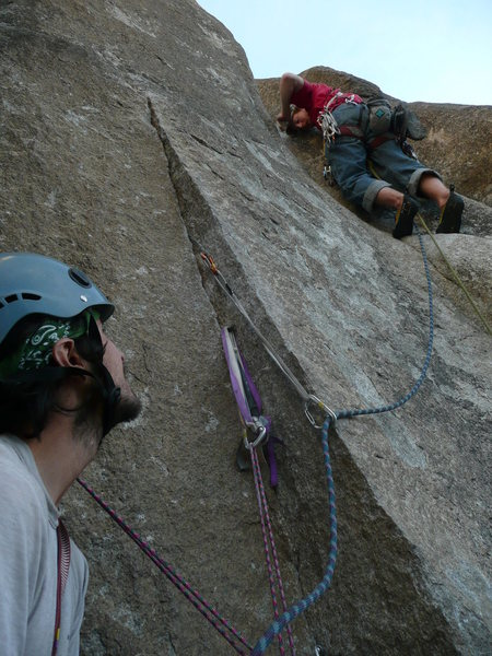 5.10b move below and left of the leader's feet, on the slab