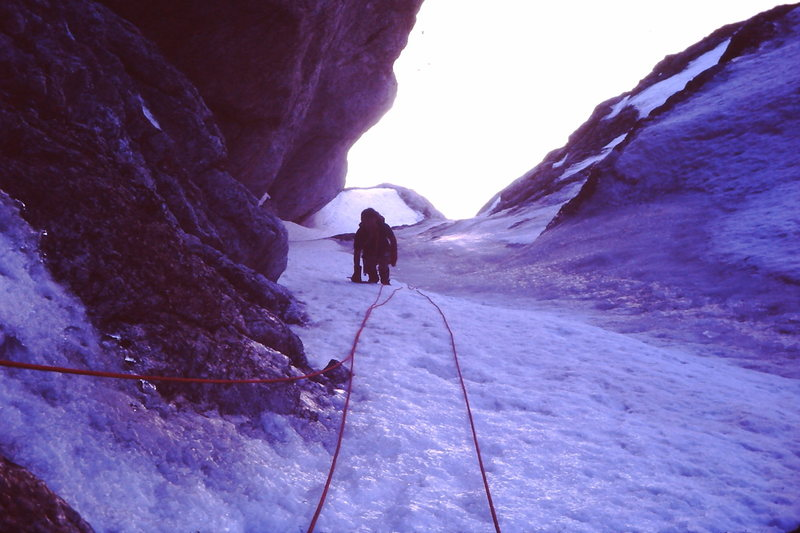 Black Ice Couloir, Summer of '82?<br> <br> Three ice tools total, one Salewa screw, one wired stopper and one piton, 8mm rope. Perfect rack!<br> <br> Bret Olson wearing shorts and Super Gaiters.<br> <br> One day trip from Rexburg, even after I spent a few hours in jail in Jackson while Bret came up with the $80 cash to pay the speeding ticket.  Jackson Cops - bad boys, bad boys, what ya gonna do!