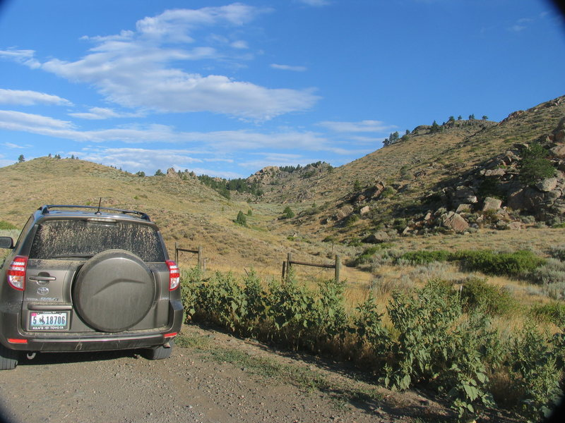 The Public Access Gate to the Laramie River Canyon Rocks visible to right of car