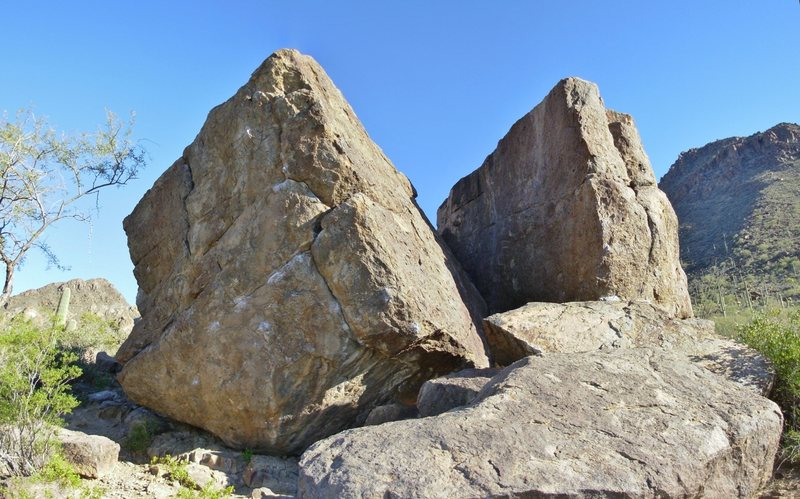 North face of the Broken Rubber Boulder (left), north face and arete of the Main Lower Boulder (right).