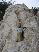 Climb up the crack to a small ledge followed by an easy face to the top.