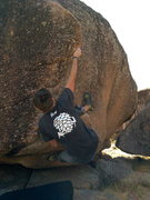 Rock Climbing Photo: Getting the heel hook and good hands to mantle.