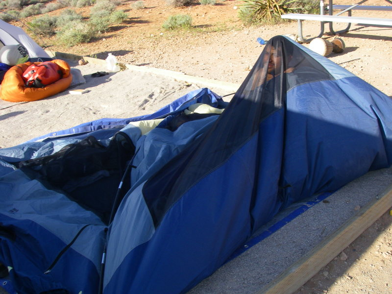 Greg in his tent after a particularly windy night at the campground.