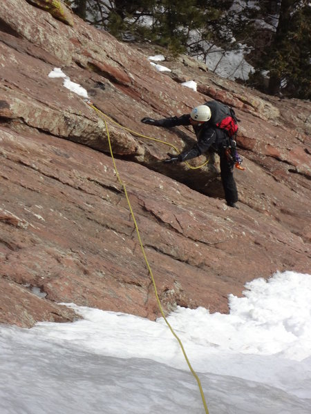 Smearing in crampons on pitch one.