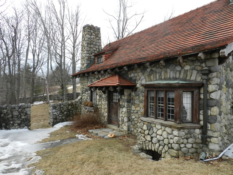 The stone house next to the parking area