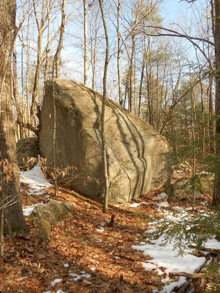 The first boulder you pass on your left after walking past hero block