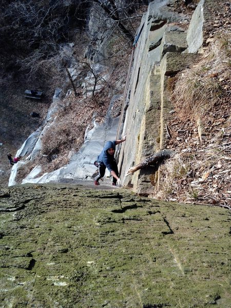 Shan gets ready to make the delicate turnaround (crux move) on Dichotomy.
